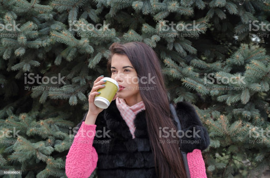 Girl with a cardboard cup stock photo
