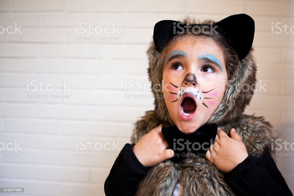 Girl with a cat costume stock photo