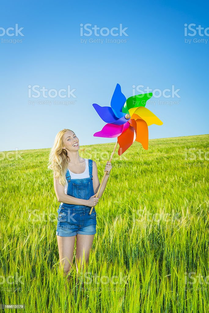 Girl with a colorful pinwheel royalty-free stock photo