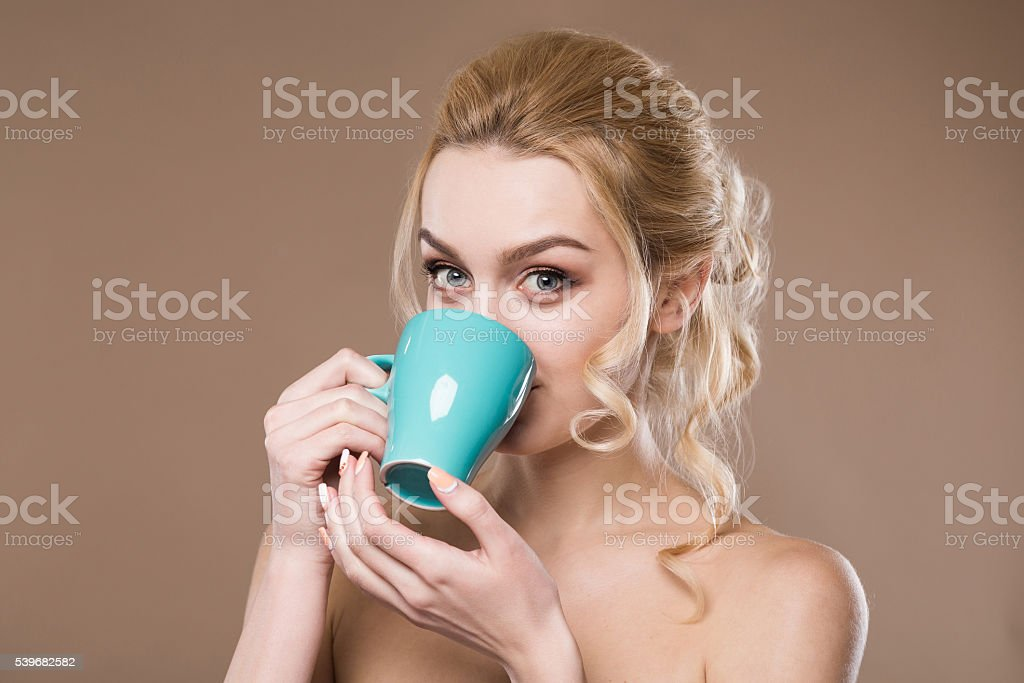Girl with a cup in his hands stock photo