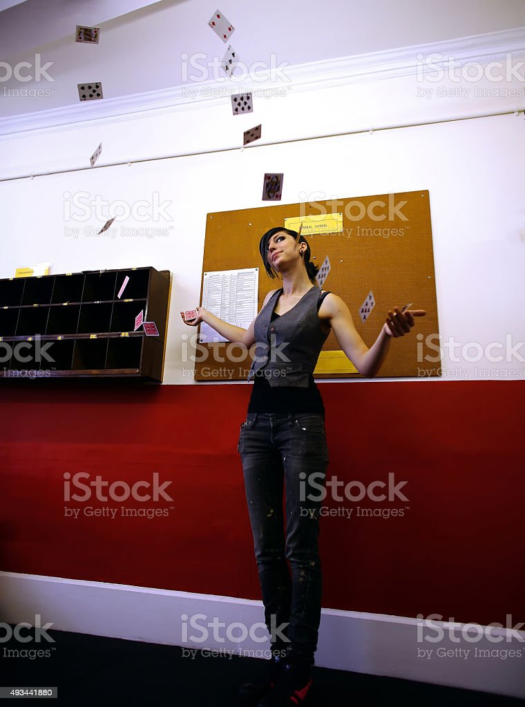 Girl with a floating deck of cards stock photo
