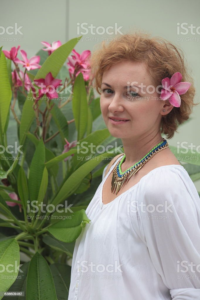 Girl with a flower stock photo