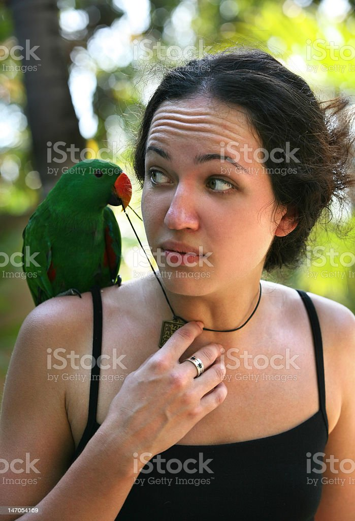 Girl with a green parrot royalty-free stock photo