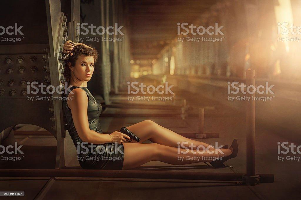 Girl with a gun. stock photo