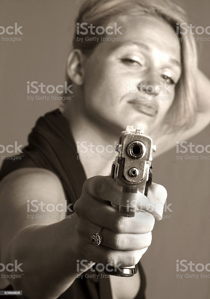 Girl with a Gun royalty-free stock photo