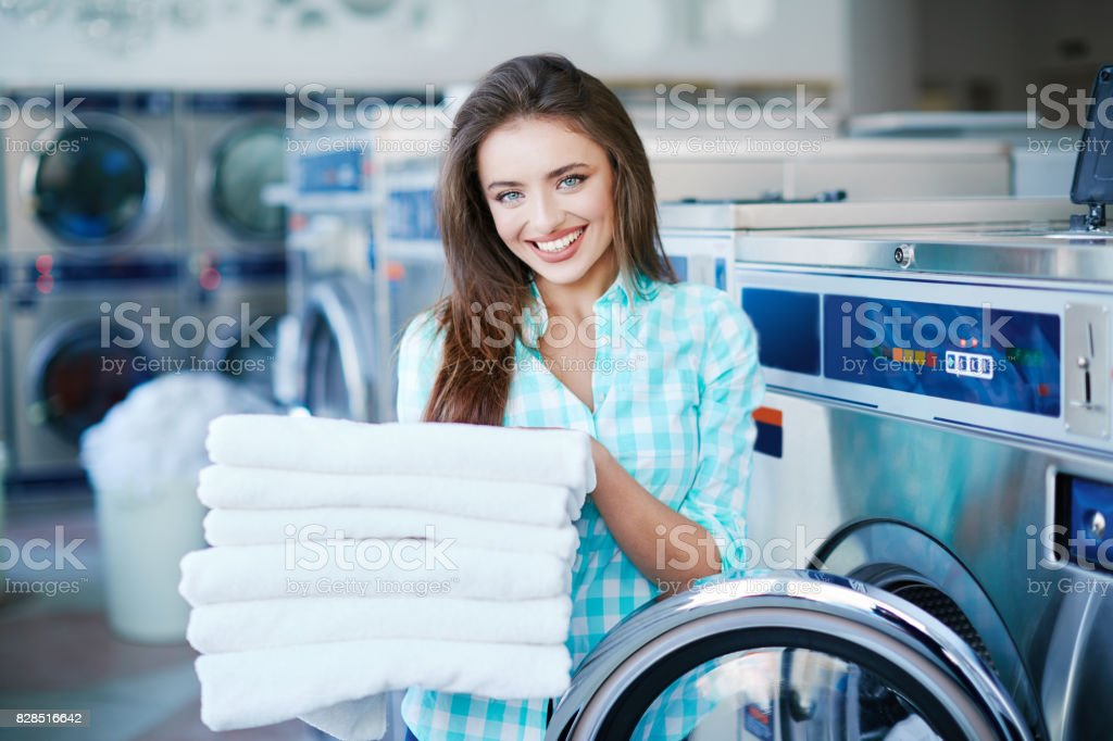 Girl with a heap of linen stock photo