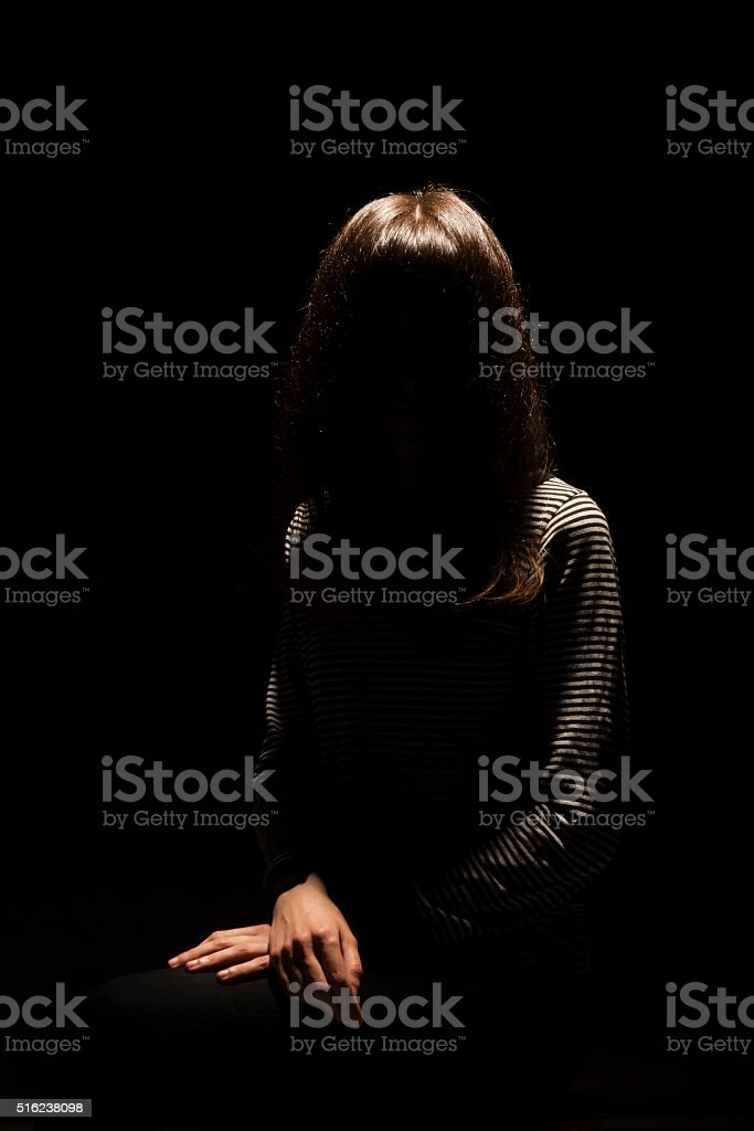 Girl with a hidden face looking scary stock photo