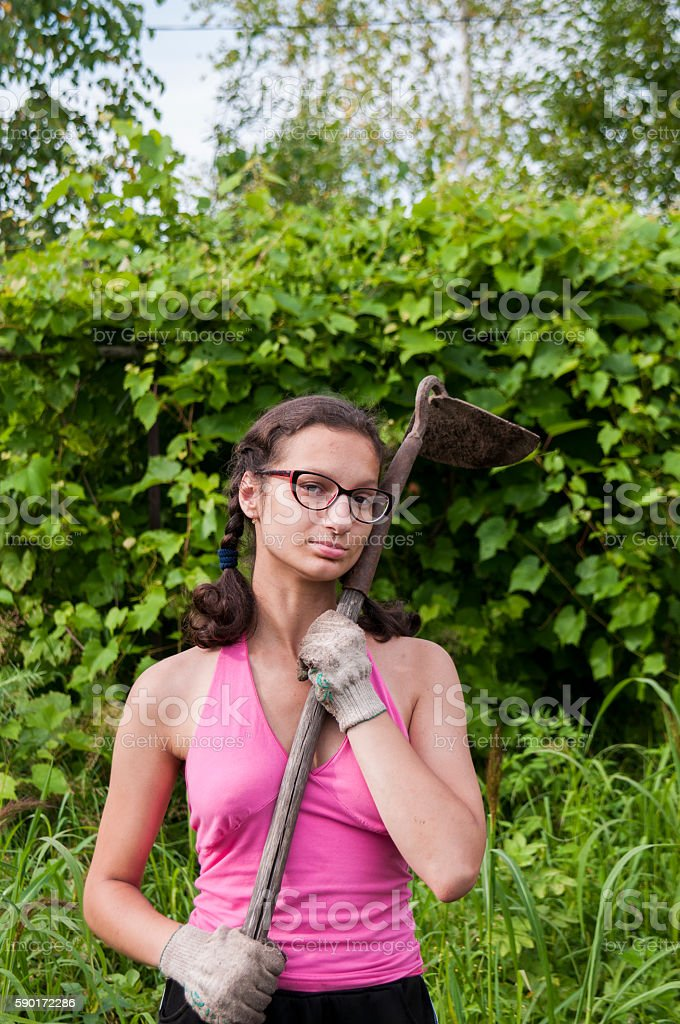Girl with a hoe on a green background stock photo