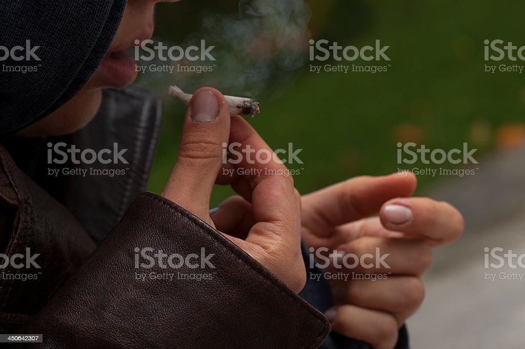 Girl with a joint stock photo