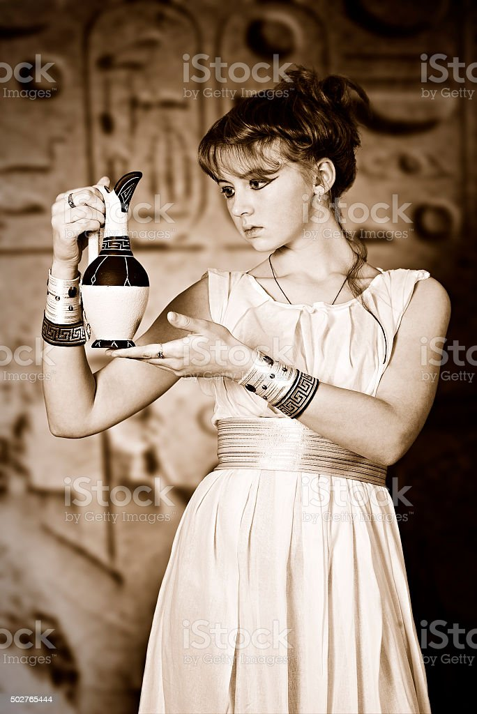Girl with a jug in antique dress stock photo