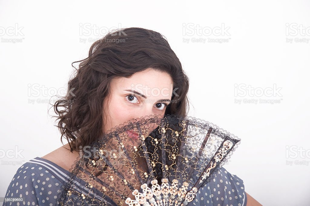 Girl with a lady's fan royalty-free stock photo