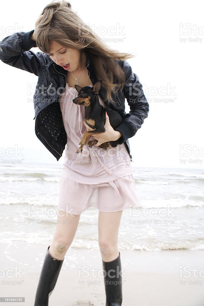 Girl with a little dog. royalty-free stock photo