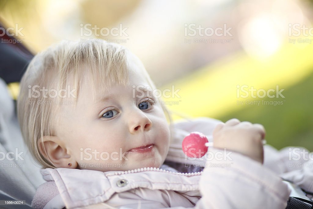 Girl with a lollipop royalty-free stock photo