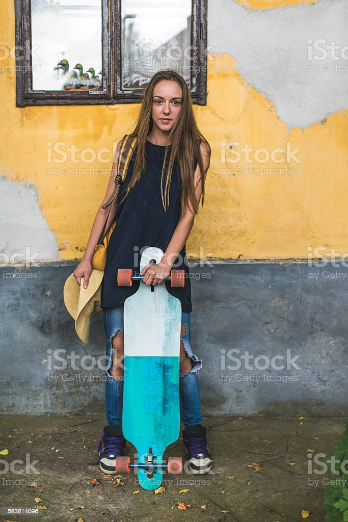 Girl with a longboard stock photo