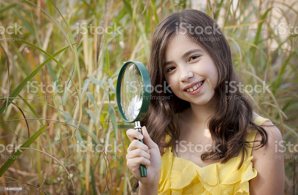 Girl with a Magnifying Glass stock photo