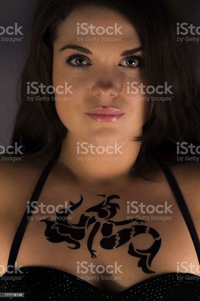 Girl with a mermaid tattoo royalty-free stock photo