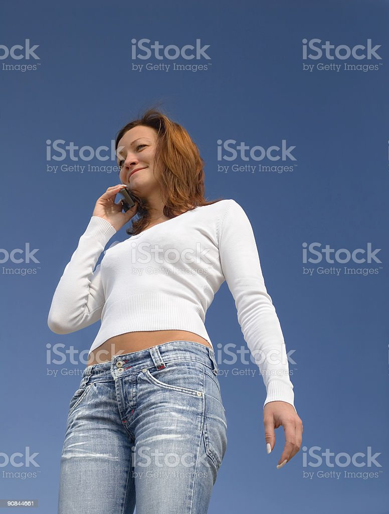 Girl with a mobile phone-1 stock photo