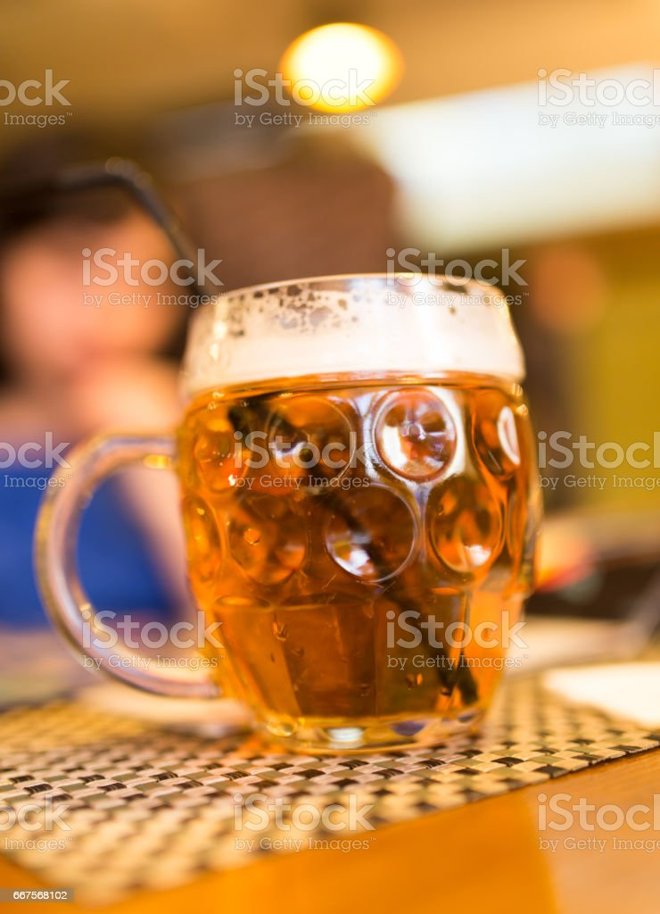 Girl with a mug of beer in a restaurant stock photo