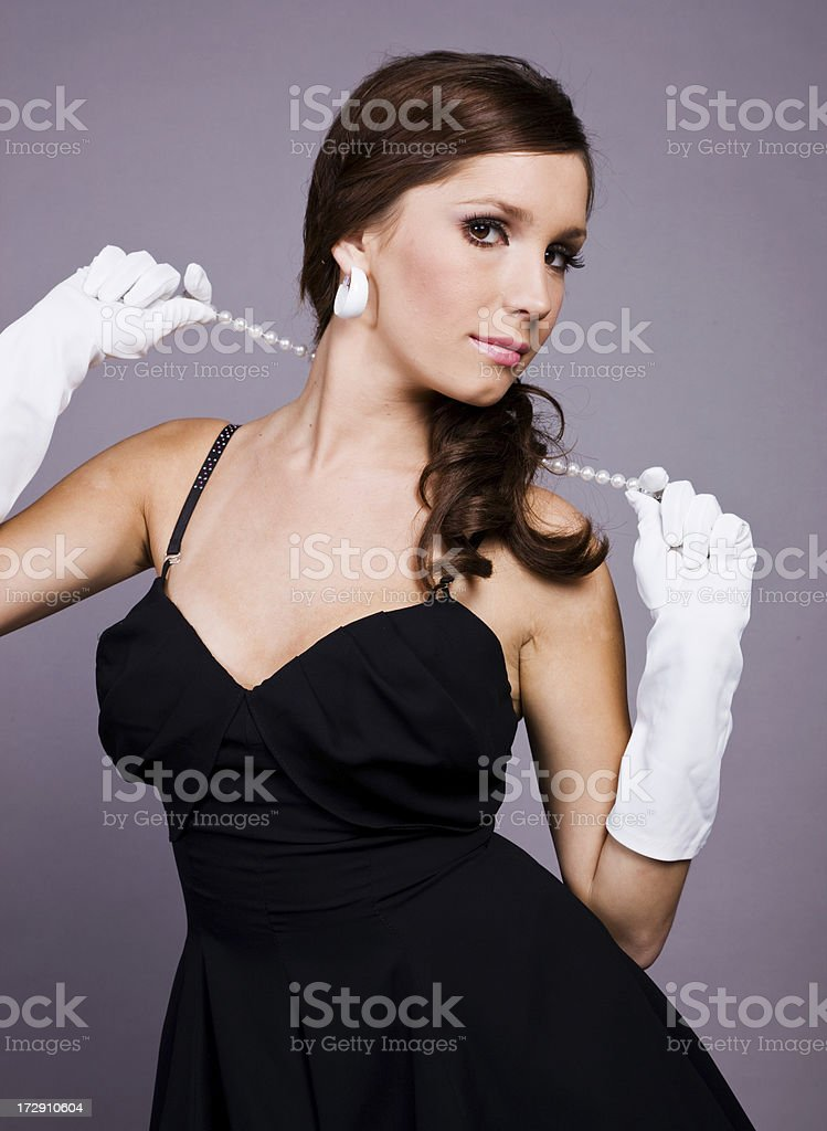 Girl with a pearl necklace royalty-free stock photo