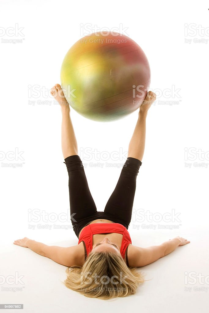 Girl with a pilates ball royalty-free stock photo