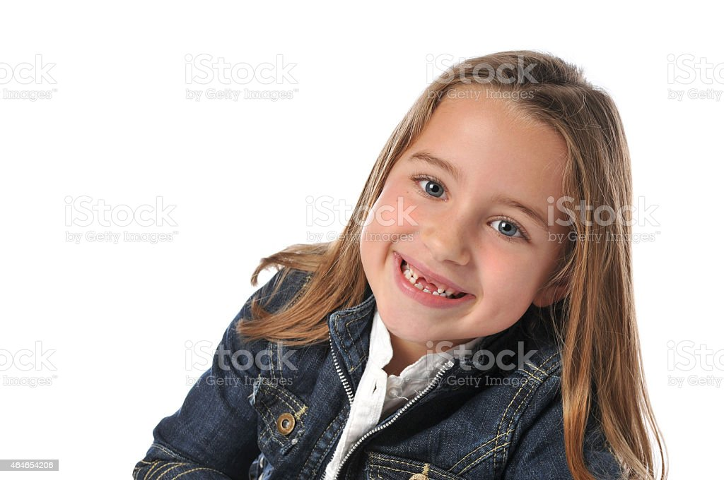 Girl with a pretty smile has two missing front teeth stock photo