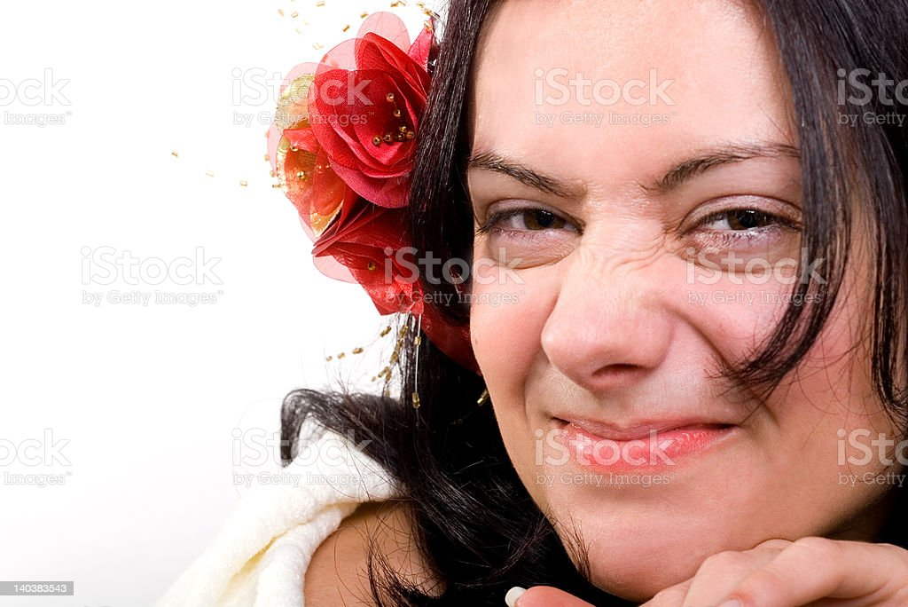 Girl with a red flower in hairs makes faces royalty-free stock photo
