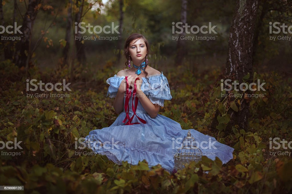 Girl with a red ribbon. stock photo