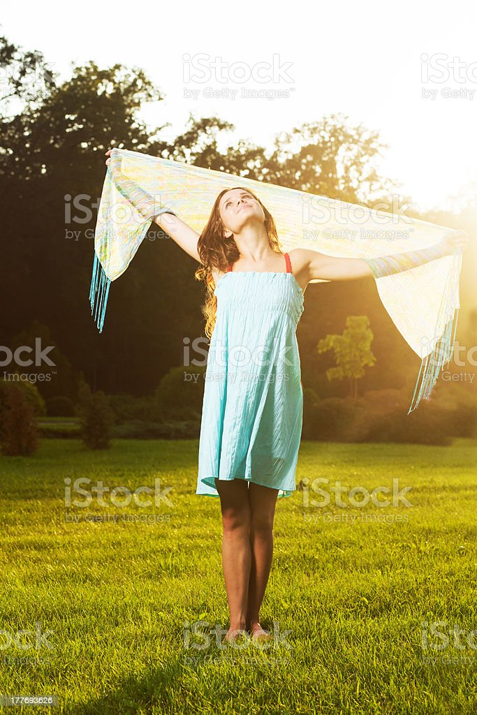 girl with a scarf on the nature stock photo