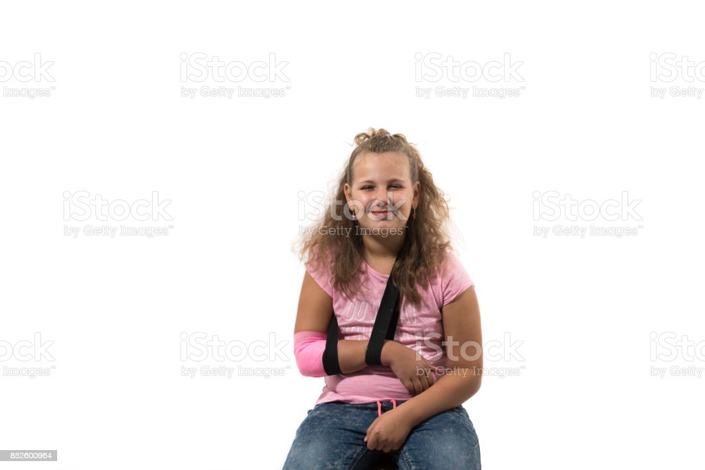 girl with a sling, after her accident stock photo