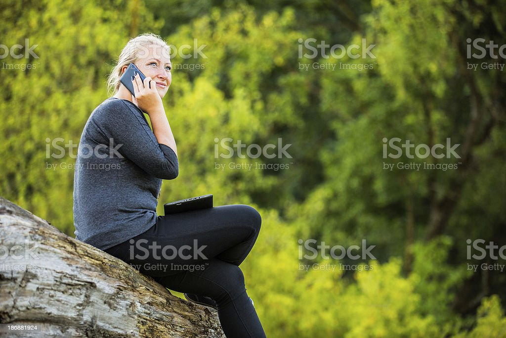 Girl with a smartphone and digital tablet royalty-free stock photo
