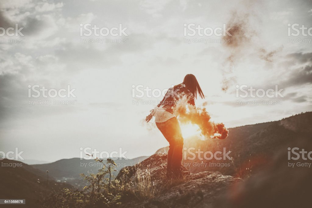 Girl with a smoke bomb stock photo