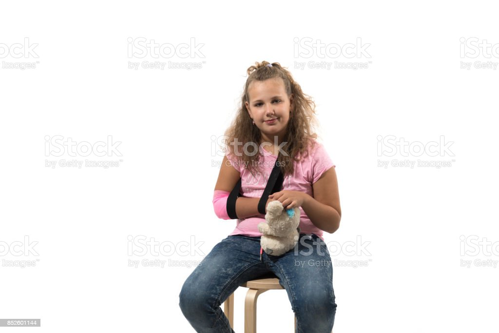 Girl with a toy after she had a accident stock photo