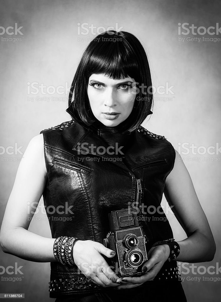 Girl with a twin-lens reflex camera stock photo