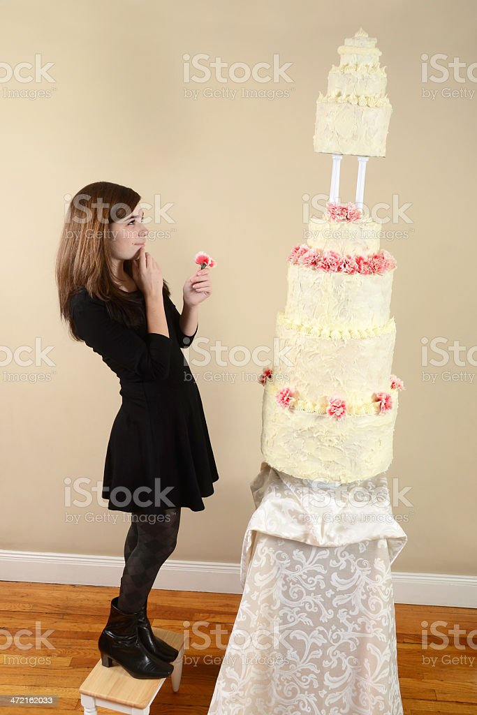 Girl With a Very Tall Cake royalty-free stock photo