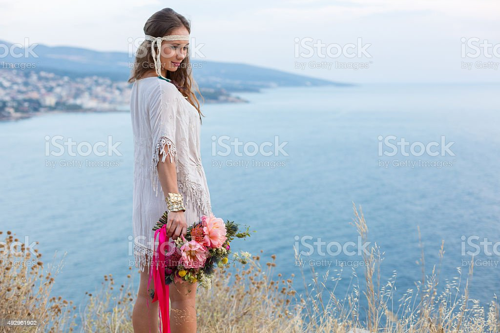 girl with a wedding bouquet boho style stock photo