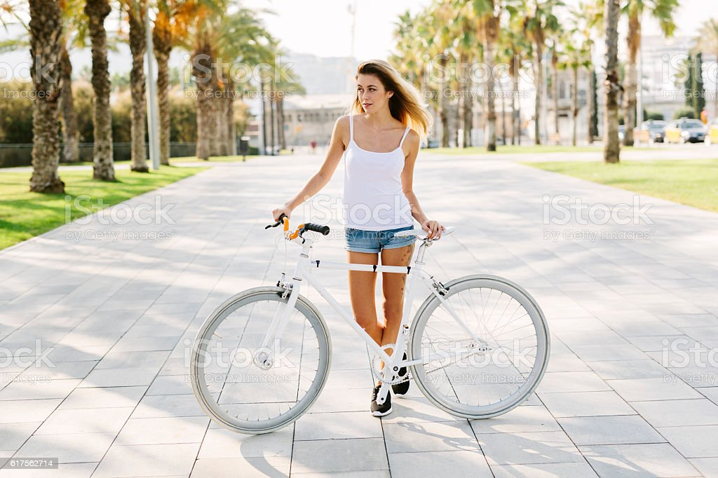 Girl with a White Bike stock photo