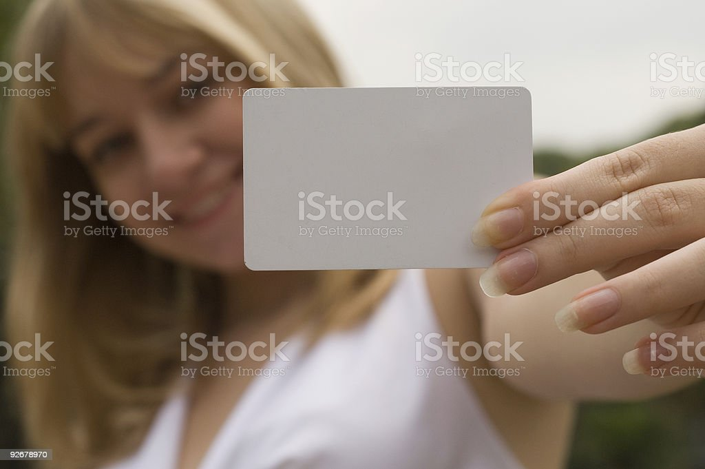 girl with a white card royalty-free stock photo