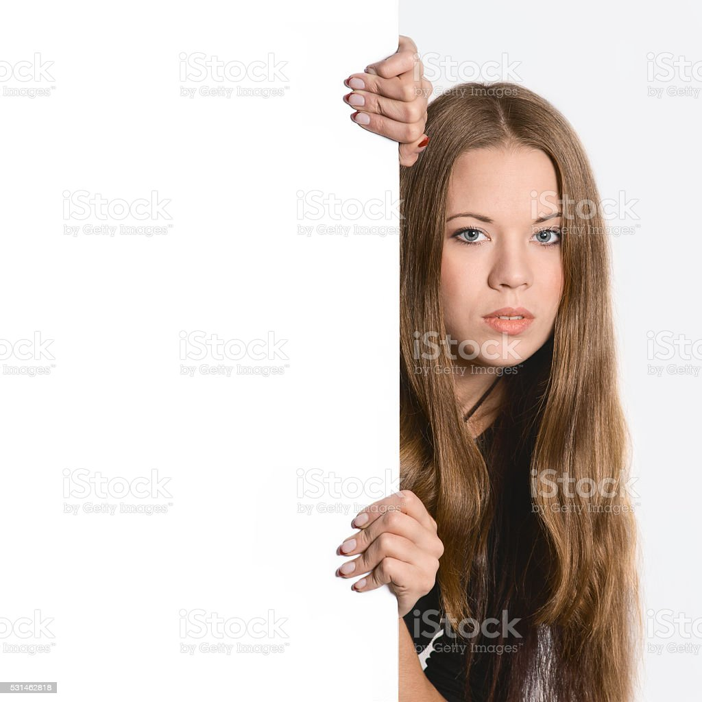 girl with a white poster for your text or image stock photo