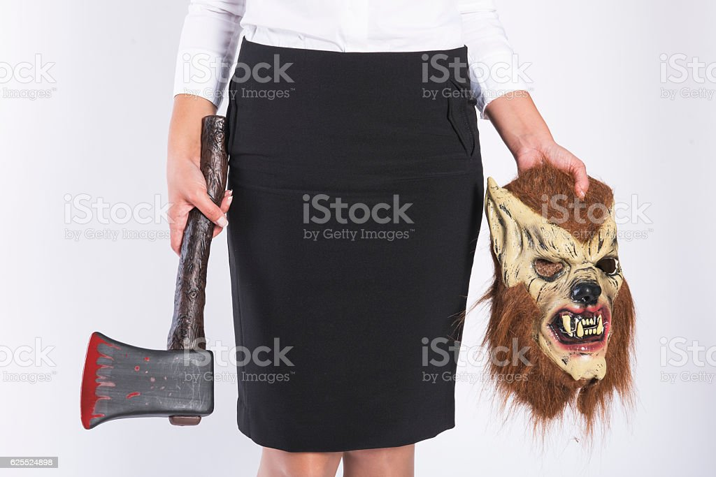 Girl with a wolf mask stock photo