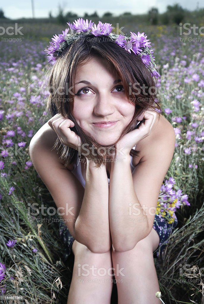 Girl With a Wreath of Flowers royalty-free stock photo