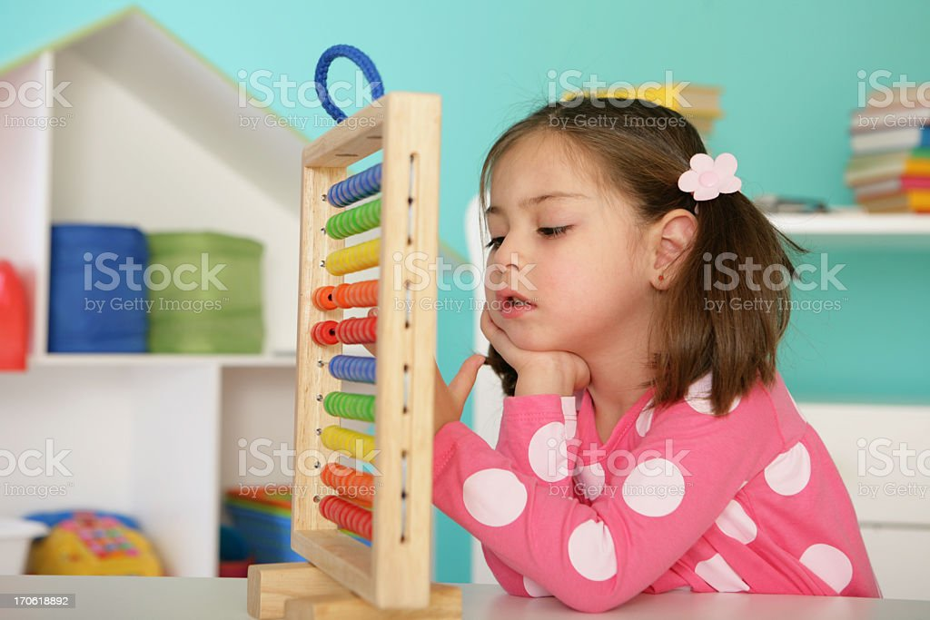girl with abacus royalty-free stock photo