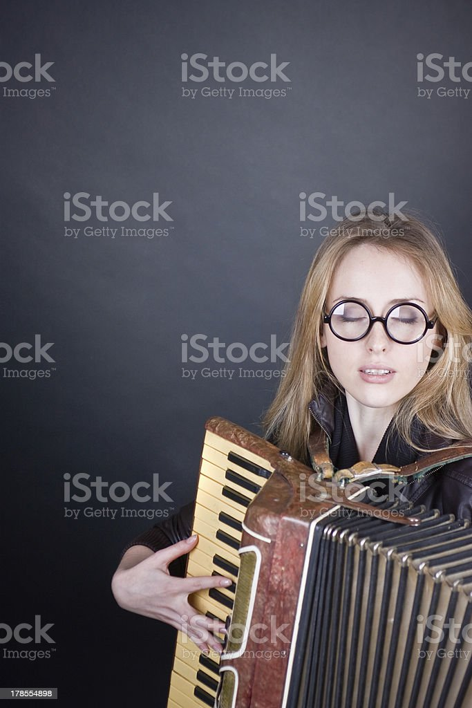 Girl with accordion and glasses royalty-free stock photo