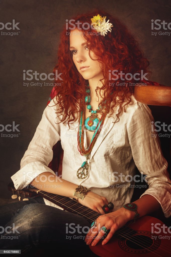 Girl with acoustic guitar stock photo