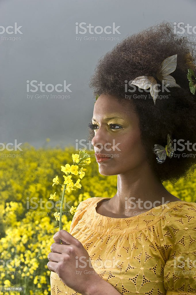 girl with afro in field royalty-free stock photo