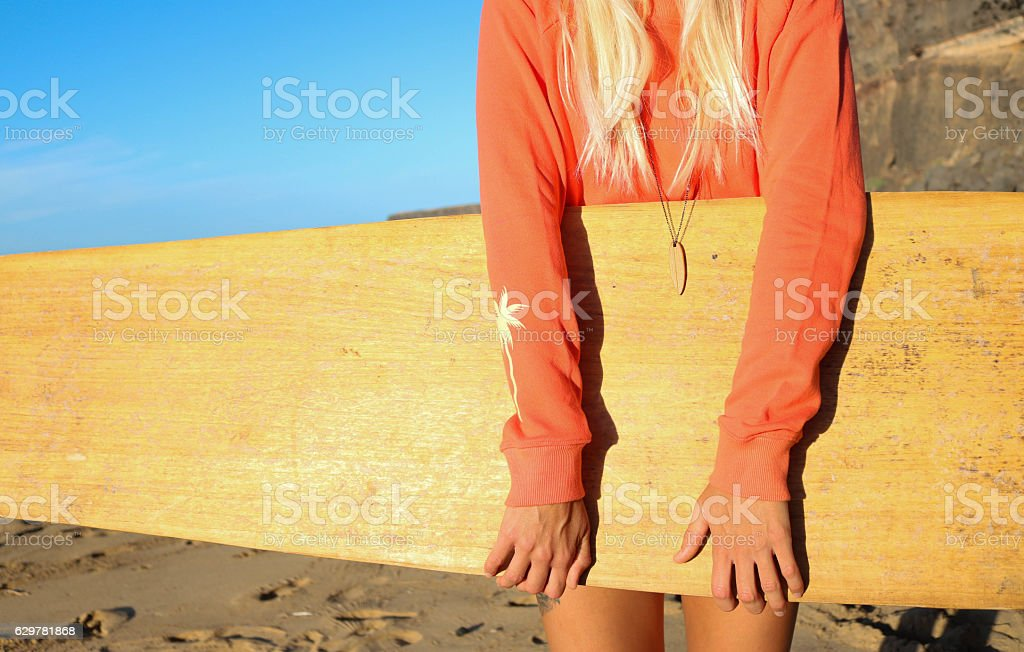 Girl with alaya surfboard on the beach stock photo