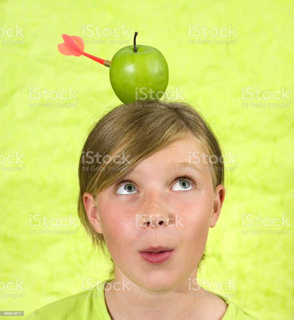 girl with an apple on her head royalty-free stock photo