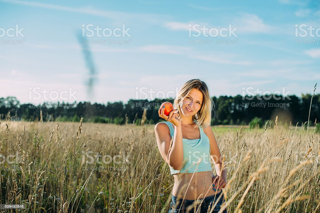 girl with an apple stock photo