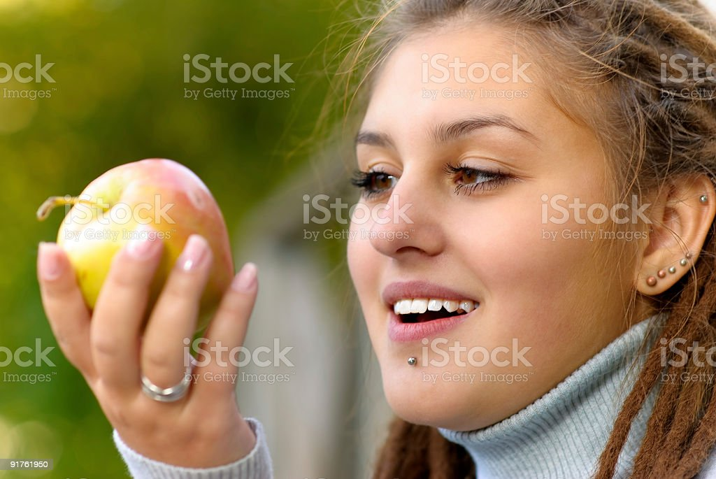 Girl with an apple royalty-free stock photo