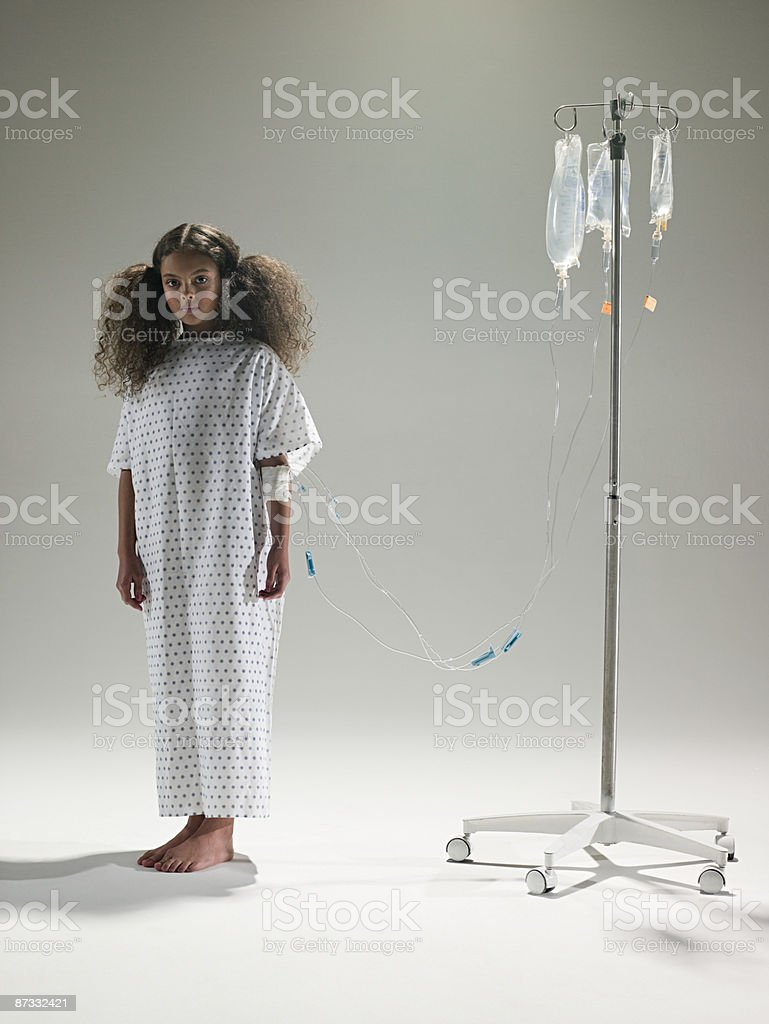 Girl with an intrvenous drip stock photo