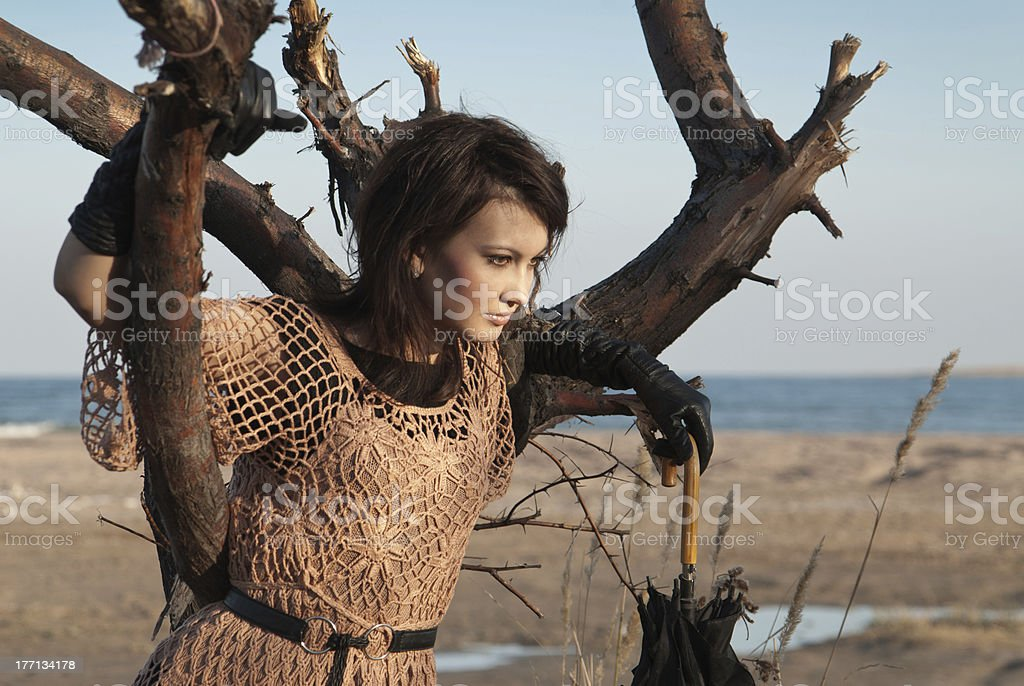 girl with an umbrella and a tree stock photo